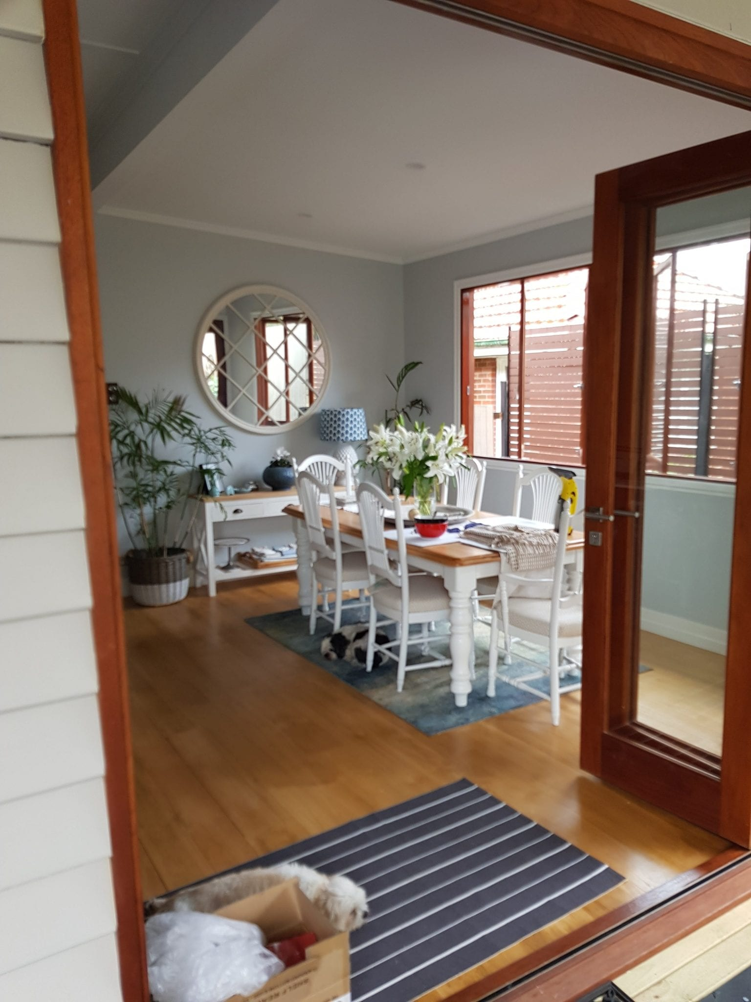 timber flooring and bifold doors and light blue interior walls