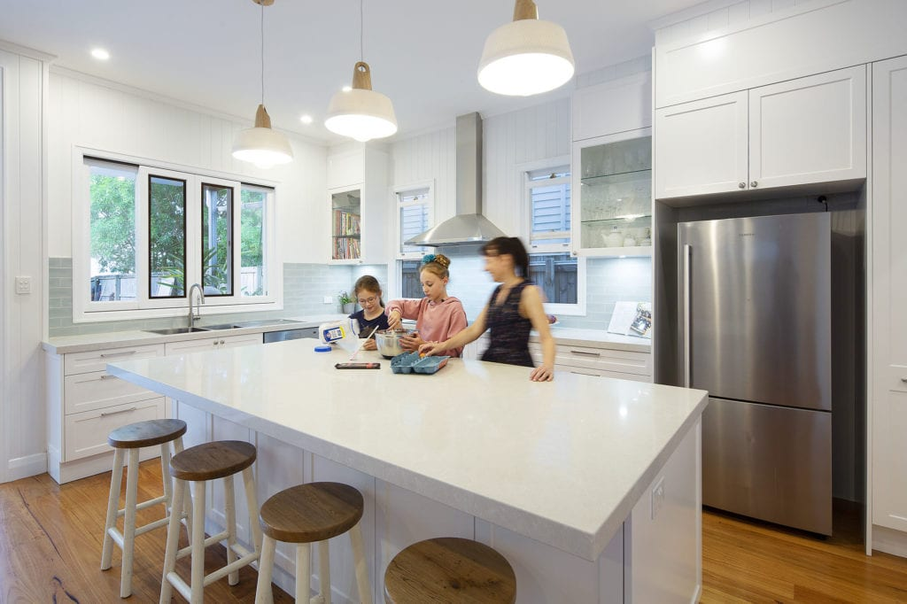 family in renovated kitchen in brisbane