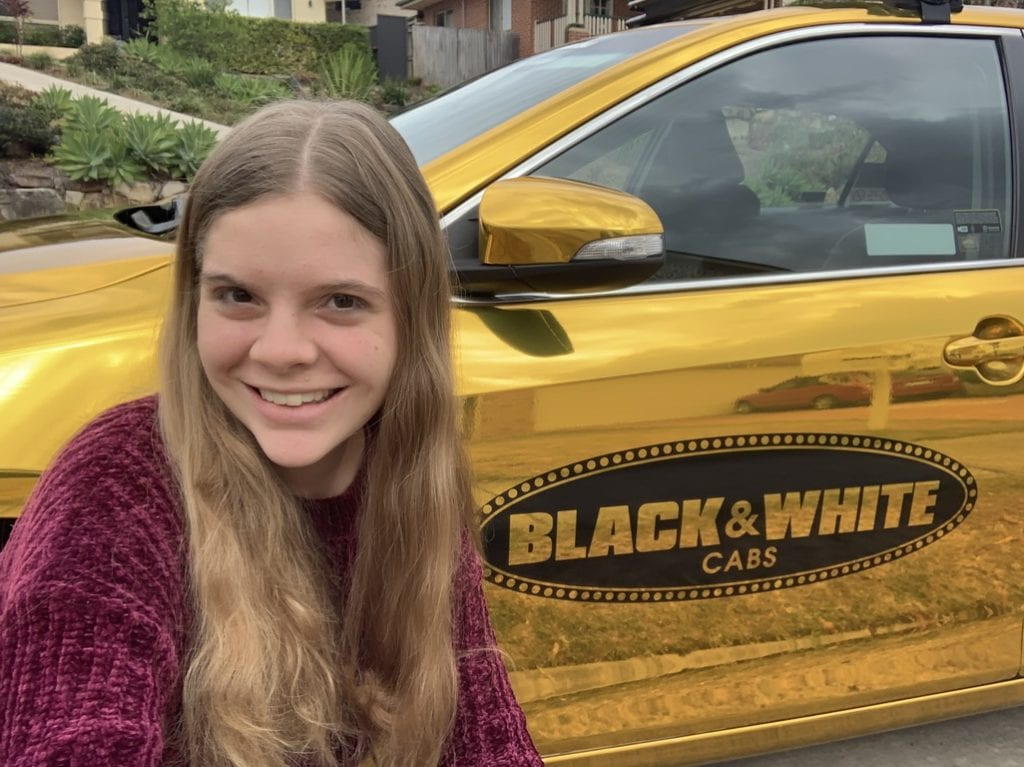 Black & White Cabs Good as Gold Young Woman
