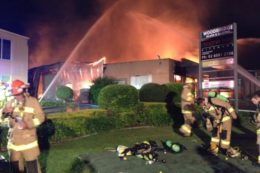 front of shop on fire