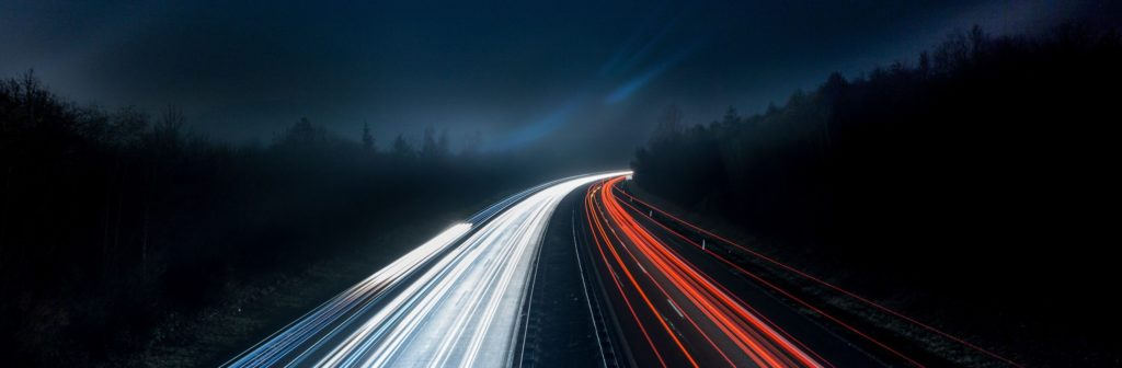 Car Traffic On A Highway At Night With Long Exposure