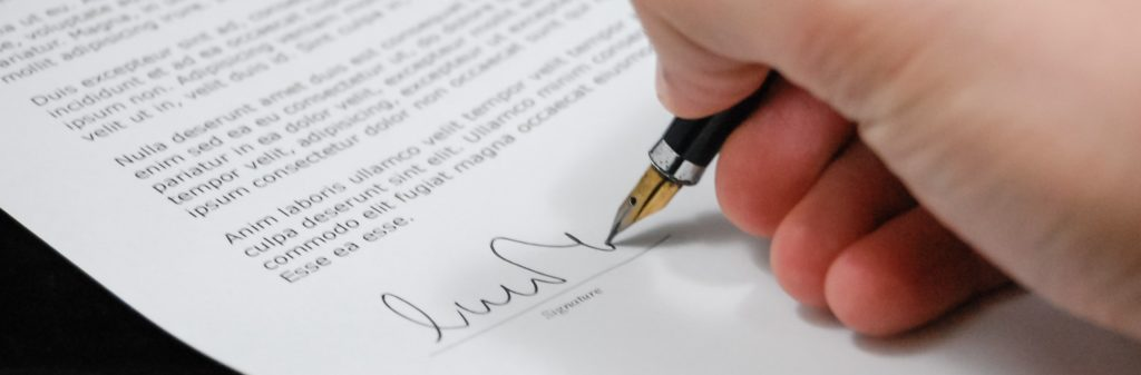signing a legal document for personal injury compensation
