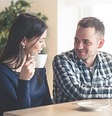 Image of a man and woman having a coffee together