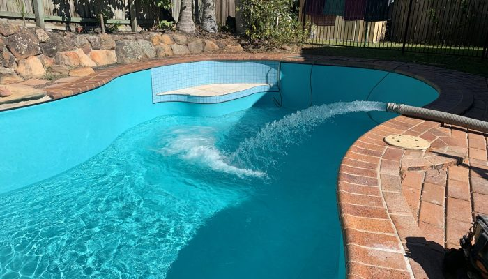 Formed concrete Exotic Pool with Aqualux Cayman