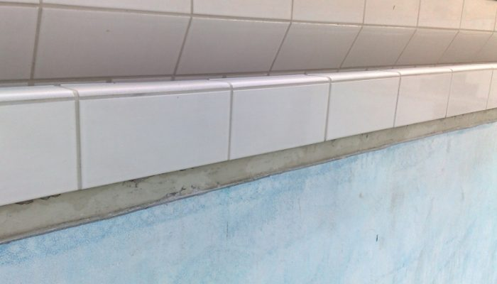 During: Part of the refurb on this pool was the tiling of the gutters and end walls