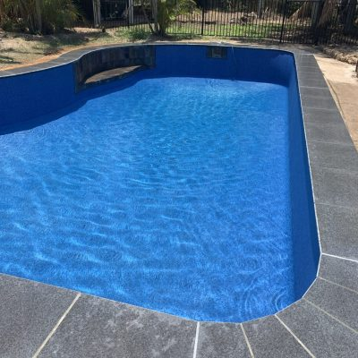 Formed concrecte Exotic Pool with Aqualux Costa Rica and Black Porcelain Black Tile Coping