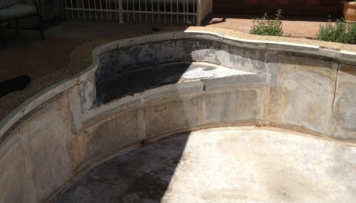 During: The pool is stripped back to a bare shell