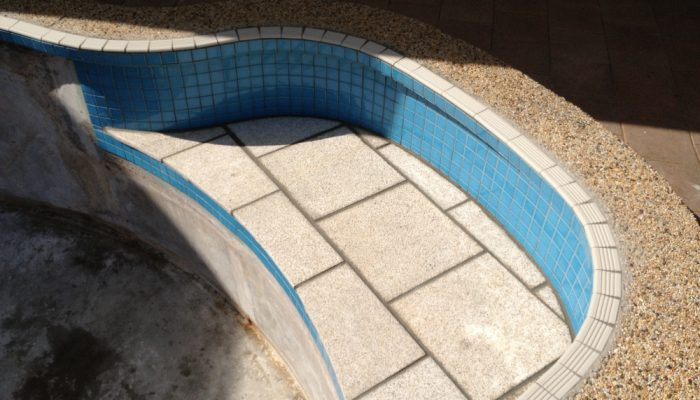 During: On this pool we replaced the tread tiles, new blue mosiacs and granite on the bench top