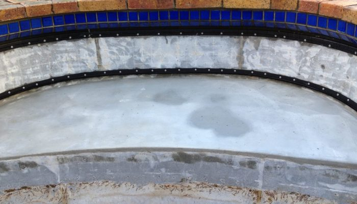 During: The step will be covered with the liner and new waterline tiles installed