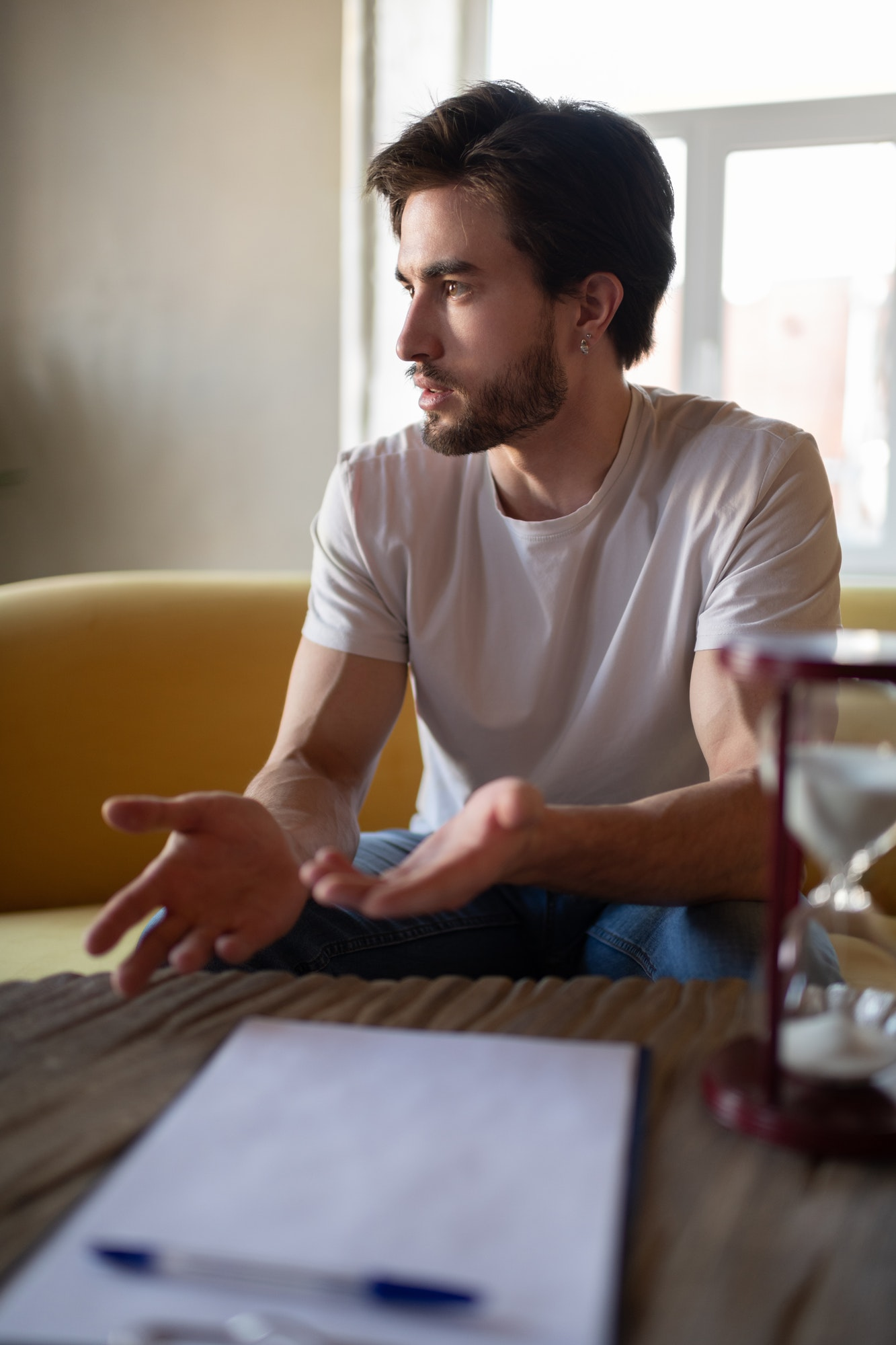 Serious man discussing mental issues during psychotherapy session