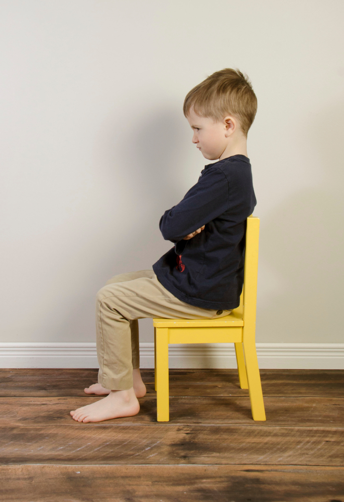 An,Angry,Young,Boy,Sits,On,A,Yellow,Time,Out