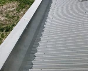 gutter guard on a corrugated box gutter roof