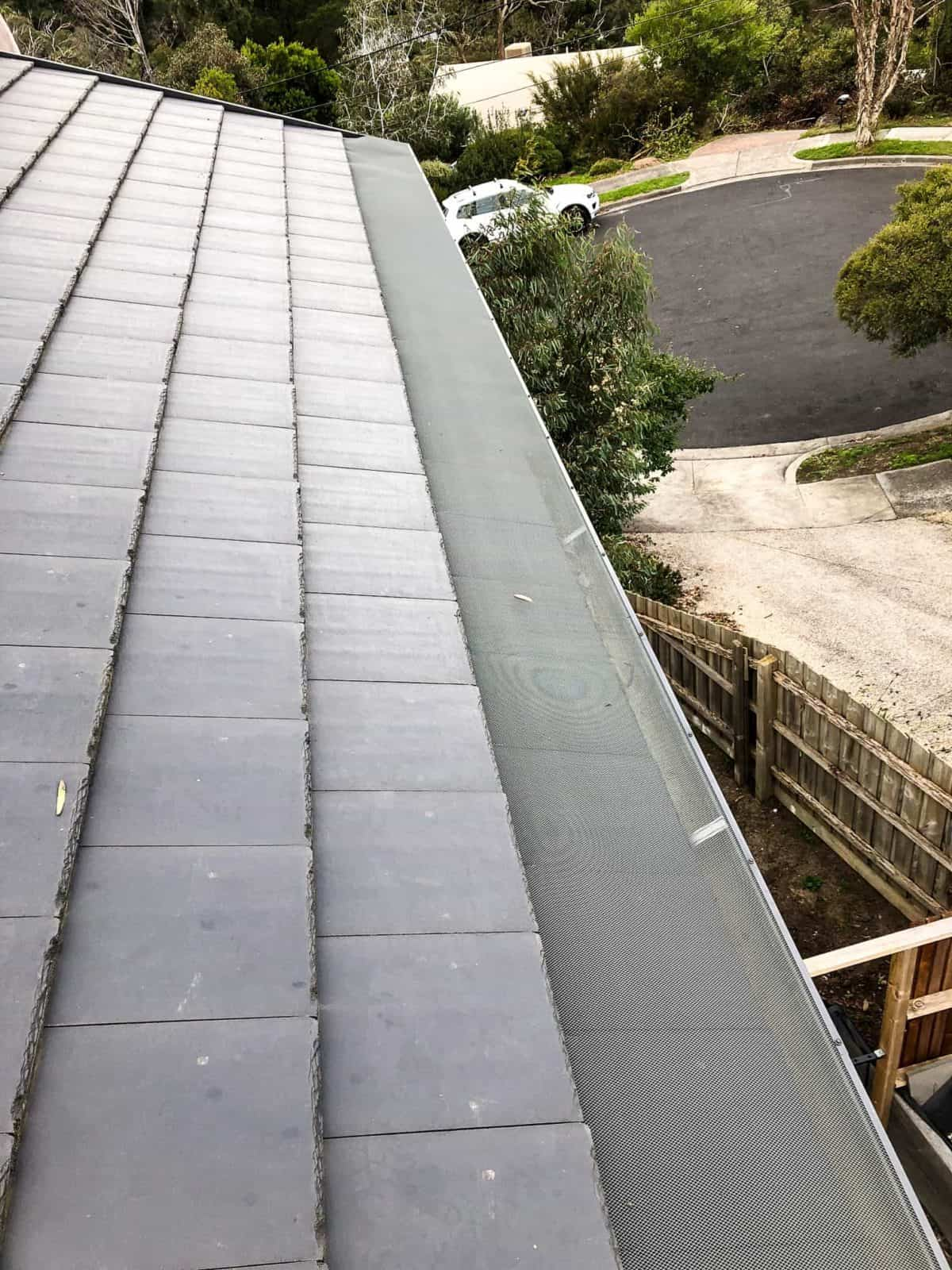 tile roof with gutter guard